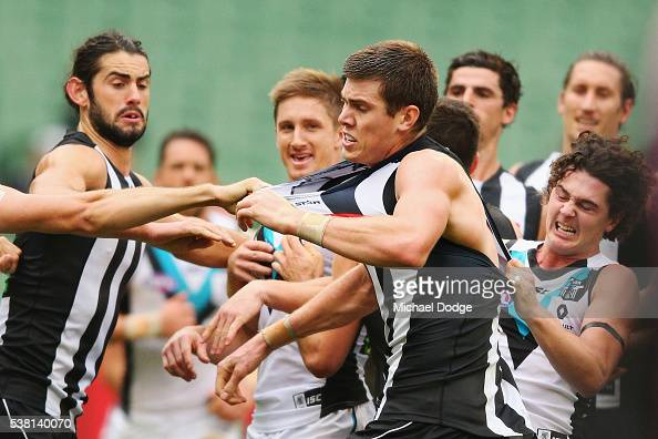 Mason Cox of the Magpies is scragged after starting a melee during the round 11 AFL match between the Collingwood Magpies and the Port Adelaide Power...