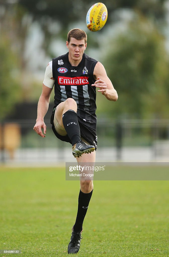 Mason Cox of the Magpies kicks the ball during a Collingwood Magpies AFL training session on May 27, 2016 in Melbourne, Australia.