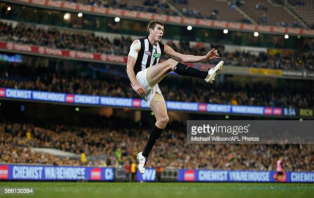Mason Cox of the Magpies kicks the ball during the 2016 AFL Round 20 match between the Richmond Tigers and the Collingwood Magpies at the Melbourne...