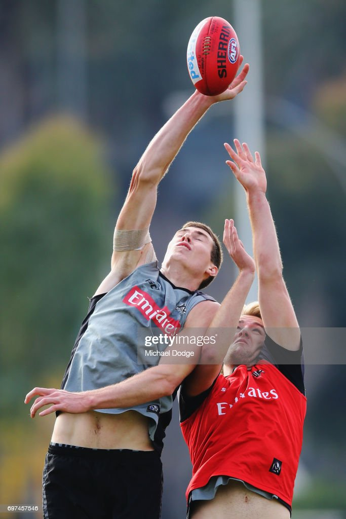 Mason Cox of the Magpies marks the ball during a Collingwood Magpies AFL training session at Gosch's Paddock on June 19, 2017 in Melbourne, Australia.