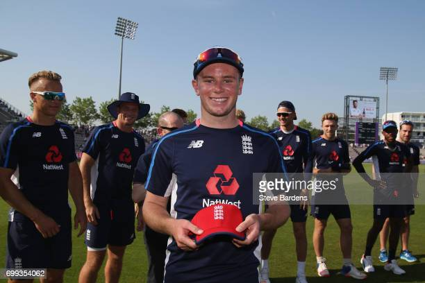 Mason Crane of England is presented with his first cap prior to the 1st NatWest T20 International match between England and South Africa at Ageas...