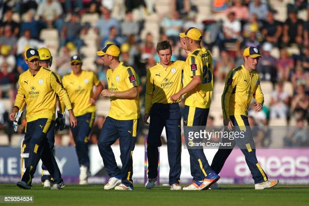 Mason Crane of Hampshire celebrates with team mates after bowling out Nick Selman of Glamorgan during the NatWest T20 Blast match between Hampshire...