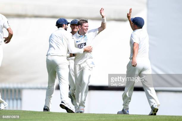 Mason Crane of New South Wales celebrates his first Sheffield Shield wicket in the Sheffield Shield match between New South Wales and South Australia...
