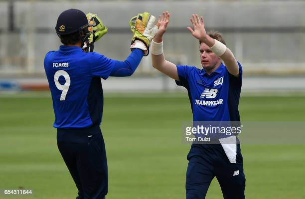 Mason Crane of The South celebrates the wicket of Sam Hain of The North during Game One of the ECB North versus South Series at Dubai International...