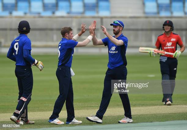 Mason Crane of The South celebrates with James Vince taking the wicket of Sam Hain of The North during Game One of the ECB North versus South Series...