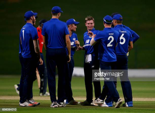 Mason Crane of The South celebrates with teammates after dismissing Sam Hain of The North during Game Three of the ECB North versus South Series at...
