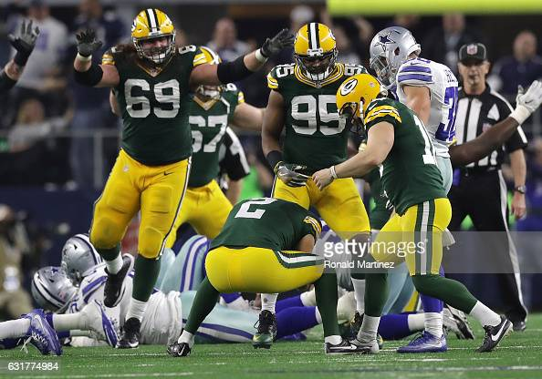 Mason Crosby of the Green Bay Packers celebrates after kicking the gamewinning field goal against the Dallas Cowboys in the NFC Divisional Playoff...