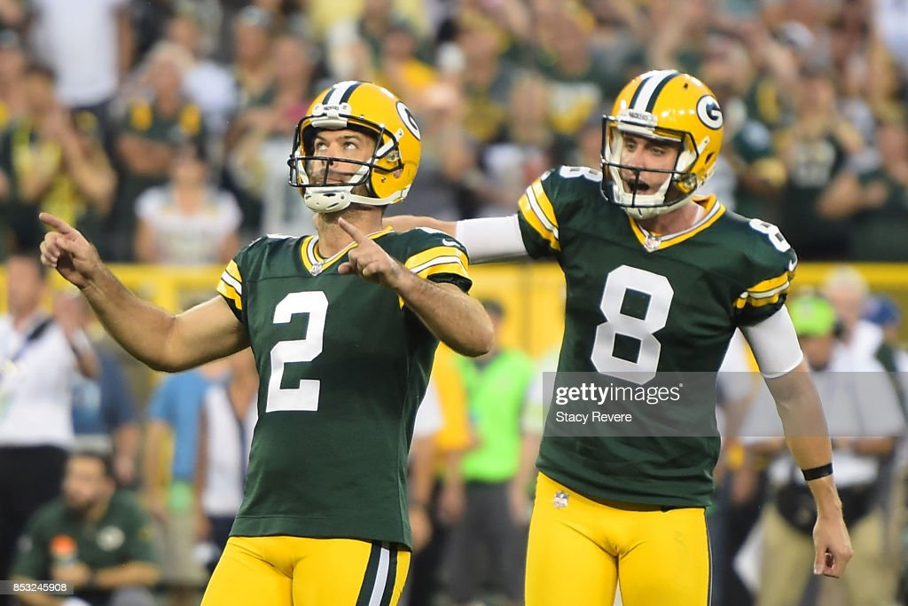Mason Crosby #2 of the Green Bay Packers celebrates after kicking the game winning field goal in overtime against the Cincinnati Bengals at Lambeau Field on September 24, 2017 in Green Bay, Wisconsin.
