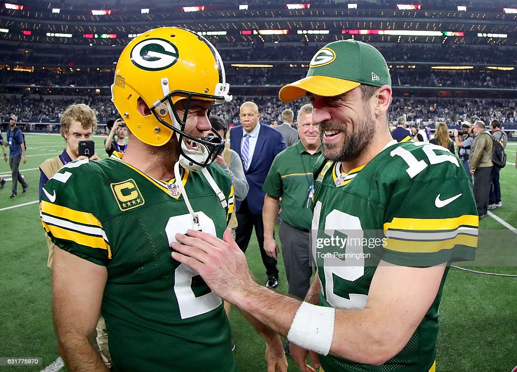 Mason Crosby #2 of the Green Bay Packers celebrates with Aaron Rodgers #12 of the Green Bay Packers after kicking the game winning field goal against the Dallas Cowboys in the final seconds of a NFC Divisional Playoff game at AT&T Stadium on January 15, 2017 in Arlington, Texas. The Green Bay Packers beat the Dallas Cowboys 34-31