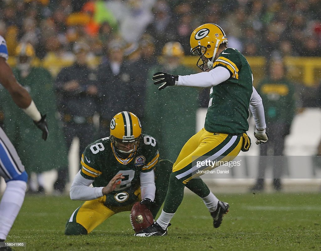 Mason Crosby #2 of the Green Bay Packers kicks a field goal out of the hold of Tim Masthay #8 against the Detroit Lions at Lambeau Field on December 9, 2012 in Green Bay, Wisconsin.