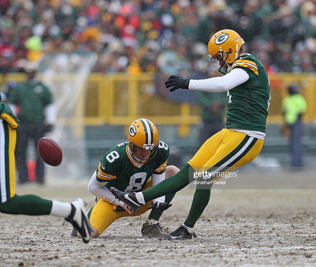 <a gi-track='captionPersonalityLinkClicked' href=/galleries/search?phrase=Mason+Crosby&family=editorial&specificpeople=2140966 ng-click='$event.stopPropagation()'>Mason Crosby</a> #2 of the Green Bay Packers kicks a field goal out of the hold of <a gi-track='captionPersonalityLinkClicked' href=/galleries/search?phrase=Tim+Masthay&family=editorial&specificpeople=4650462 ng-click='$event.stopPropagation()'>Tim Masthay</a> #8 against the Atlanta Falcons at Lambeau Field on December 8, 2013 in Green Bay, Wisconsin.