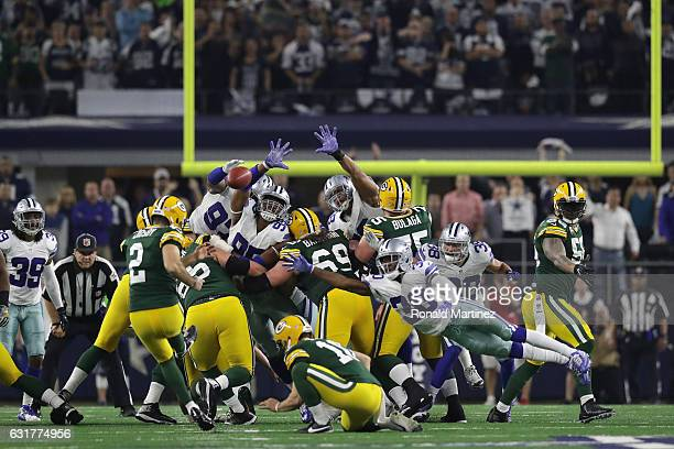 Mason Crosby of the Green Bay Packers kicks the game winning field goal as time expires against the Dallas Cowboys in the NFC Divisional Playoff game...