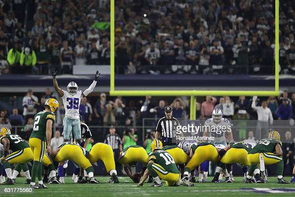 Mason Crosby of the Green Bay Packers lines up to kick the gamewinning field goal against the Dallas Cowboys in the NFC Divisional Playoff game at...