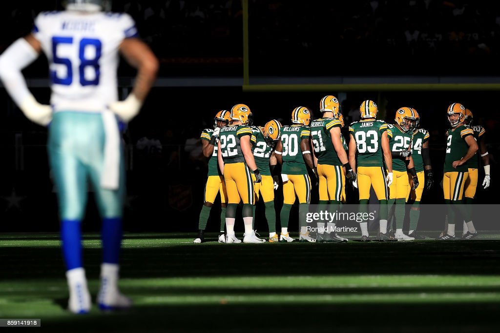 Mason Crosby #2 of the Green Bay Packers prepares to kick off to the Dallas Cowboys in the fourth quarter at AT&T Stadium on October 8, 2017 in Arlington, Texas.