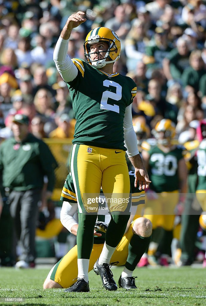 Mason Crosby #2 of the Green Bay Packers reacts to his third field goal of the game for a 9-3 lead over the Detroit Lions at Lambeau Field on October 6, 2013 in Green Bay, Wisconsin.