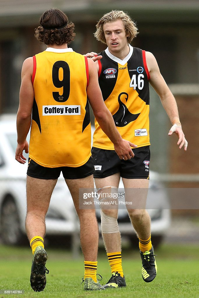 Mason De Wit of the Dandenong Stingrays (L) celebrates a goal with team mate Luke Davies-Uniacke of the Dandenong Stingrays during the round eight TAC Cup match between Dandenong Stingrays and Geelong Falcons at Shepley Oval on May 29, 2016 in Melbourne, Australia.
