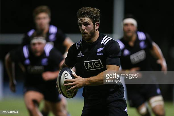 Mason Emerson of New Zealand runs the ball during the Under 20s Oceania Rugby match between Australia and New Zealand at Bond University on May 3...