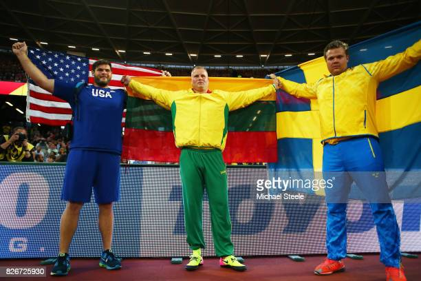 Mason Finley of the United States Andrius Gudžius of Lithuania and Daniel Ståhl of Sweden celebrate follwoing the Mens Discus Final during day two of...