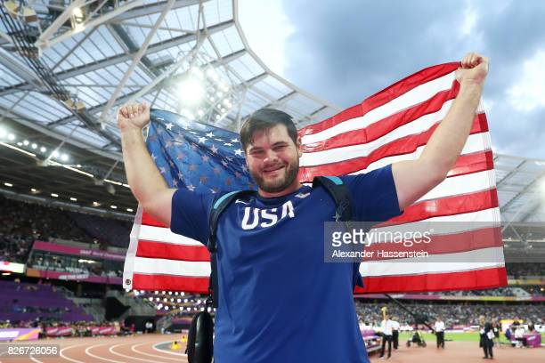 Mason Finley of the United States holds his national flah aloft following finishing third in the Mens Discus Final during day two of the 16th IAAF...