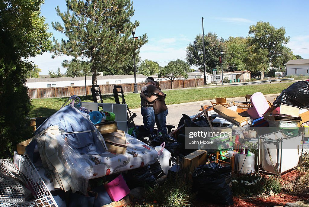 Mason Fitzgerald embraces his daughter Brandie Barbiere after her household possessions were removed to the front yard during a home foreclosure on October 5, 2011 in Milliken, Colorado. Barbiere said she had stopped making the mortgage payments 11 months before, after she lost more than half her home child care business due to the continued weak economy. A nationwide glut of foreclosed homes is expected to depress U.S. housing values for years.