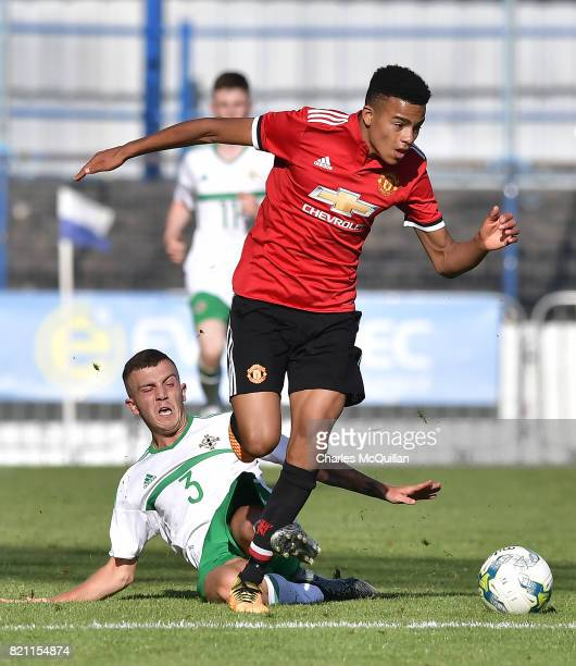 Mason Greenwood of Manchester United and Chris Crane of Northern Ireland during the NI Super Cup game between Manchester United u18s and Northern...