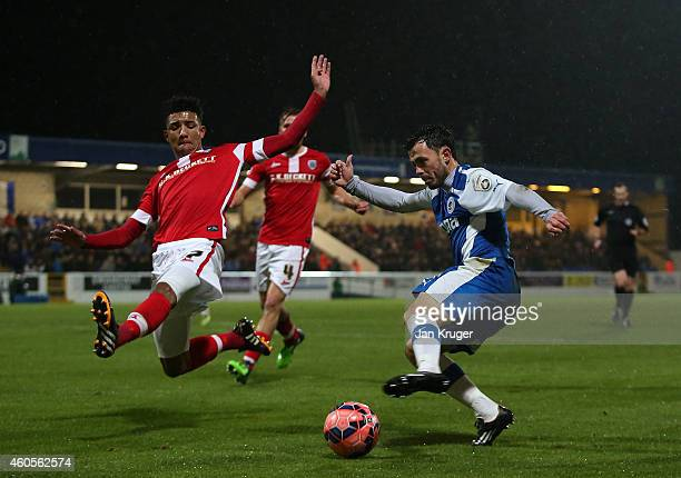 Mason Holgate of Barnsley blocks a shot at goal from Craig Mahon of Chester during the FA Cup Second Round Replay match between Chester City and...