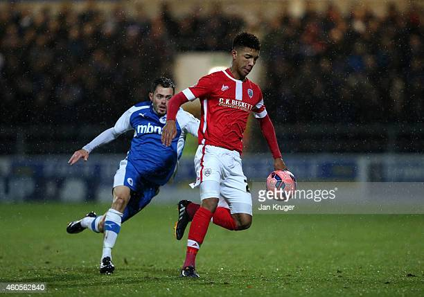 Mason Holgate of Barnsley clears the ball from Craig Mahon of Chester during the FA Cup Second Round Replay match between Chester City and Barnsley...