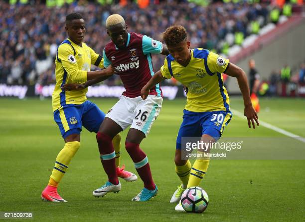 Mason Holgate of Everton and Ademola Lookman of Everton close down Arthur Masuaku of West Ham United during the Premier League match between West Ham...