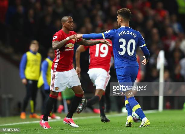 Mason Holgate of Everton and Ashley Young of Manchester United confront each other during the Premier League match between Manchester United and...