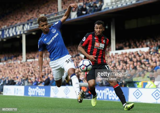 Mason Holgate of Everton and Joshua King of AFC Bournemouth compete for the ball during the Premier League match between Everton and AFC Bournemouth...