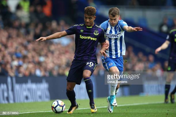 Mason Holgate of Everton and Solly March of Brighton and Hove Albion during the Premier League match between Brighton and Hove Albion and Everton at...
