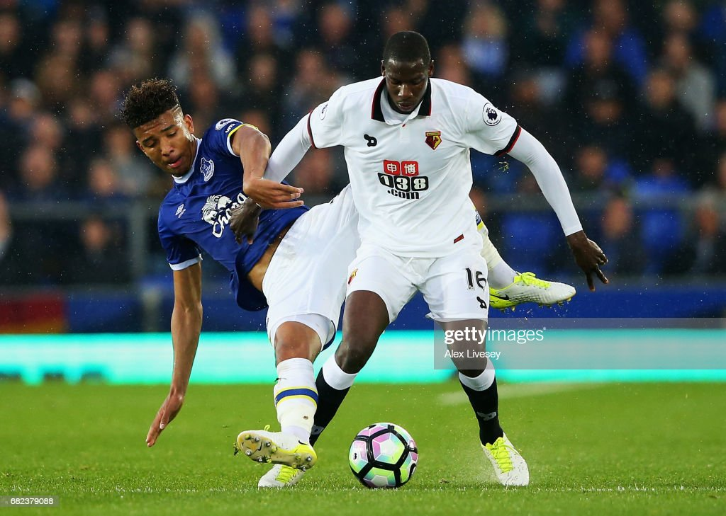 Mason Holgate of Everton attempts to tackle Abdoulaye Doucoure of Watford during the Premier League match between Everton and Watford at Goodison Park on May 12, 2017 in Liverpool, England.
