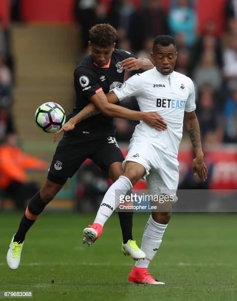 Mason Holgate of Everton challenges Jordan Ayew of Swansea City during the Premier League match between Swansea City and Everton at the Liberty...