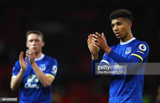 Mason Holgate of Everton shows appreciation to the fans after the Premier League match between Manchester United and Everton at Old Trafford on April...
