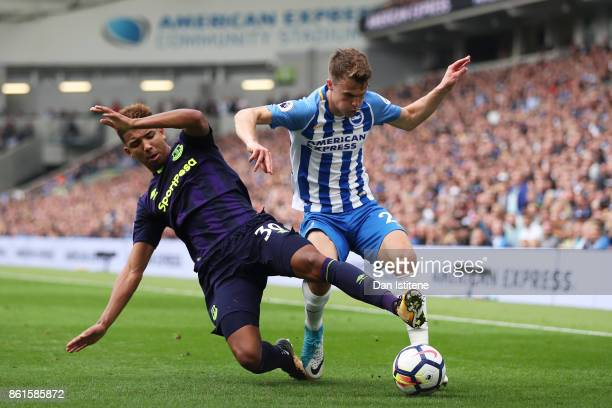 Mason Holgate of Everton tackles Solly March of Brighton and Hove Albion during the Premier League match between Brighton and Hove Albion and Everton...