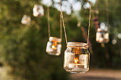 mason jar candle hanging on tree for wedding decor