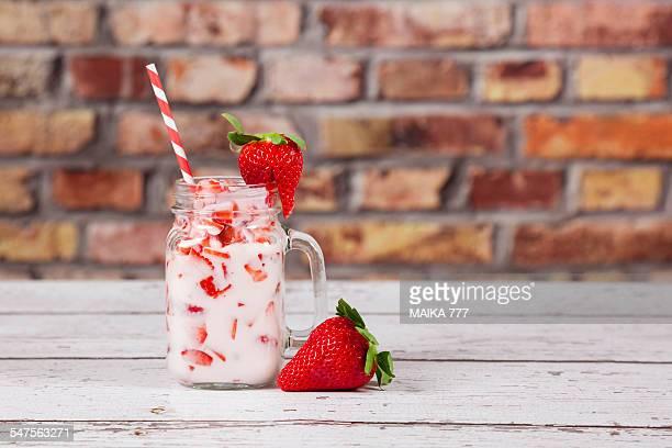 Mason jar of strawberry and yogurt