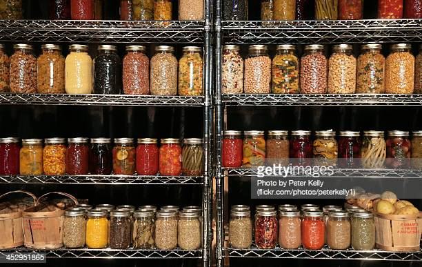Mason jars with pickles, preserves and food stuffs