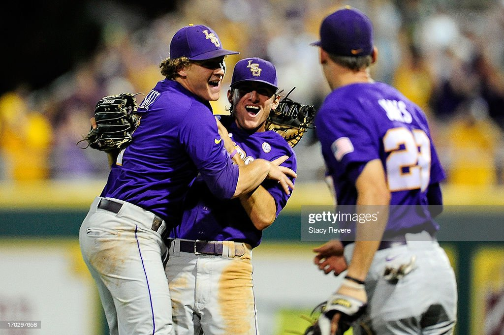 Mason Katz #8, JaCoby Jones #23 and Chris Sciambra #5 of the LSU Tigers celebrate a victory over the Oklahoma Sooners following game 2 of the NCAA baseball Super Regionals at Alex Box Stadium on June 8, 2013 in Baton Rouge, Louisiana.