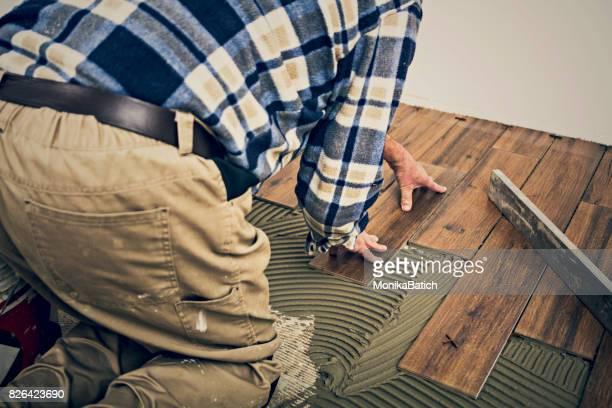 Mason placing  tiles