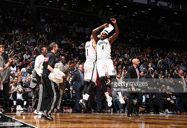 Mason Plumlee and Andray Blatche of the Brooklyn Nets celebrate during a game against the Memphis Grizzlies at the Barclays Center on March 5 2014 in...