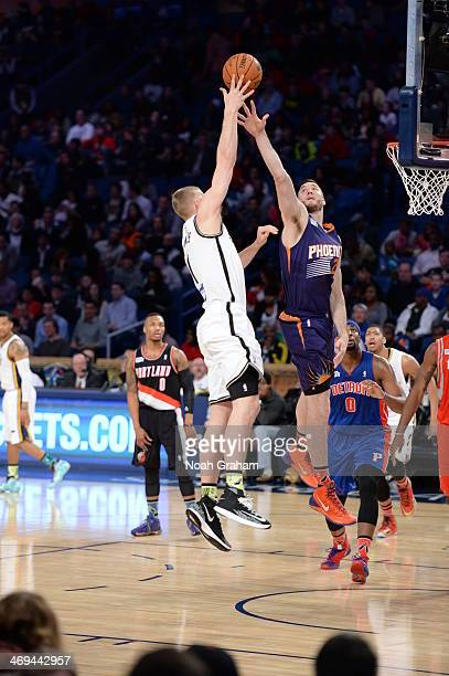 Mason Plumlee of Team Webber shoots against Miles Plumlee of Team Hill during the 2014 BBVA Compass Rising Stars Challenge at Smoothie King Center on...