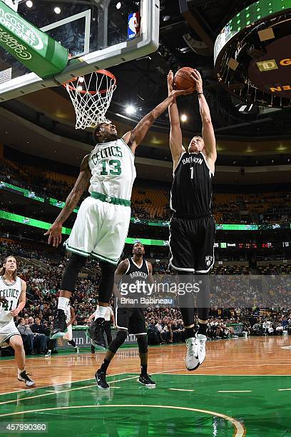 Mason Plumlee of the Brooklyn Nets and James Young of the Boston Celtics go up for a rebound on October 22 2014 at the TD Garden in Boston...