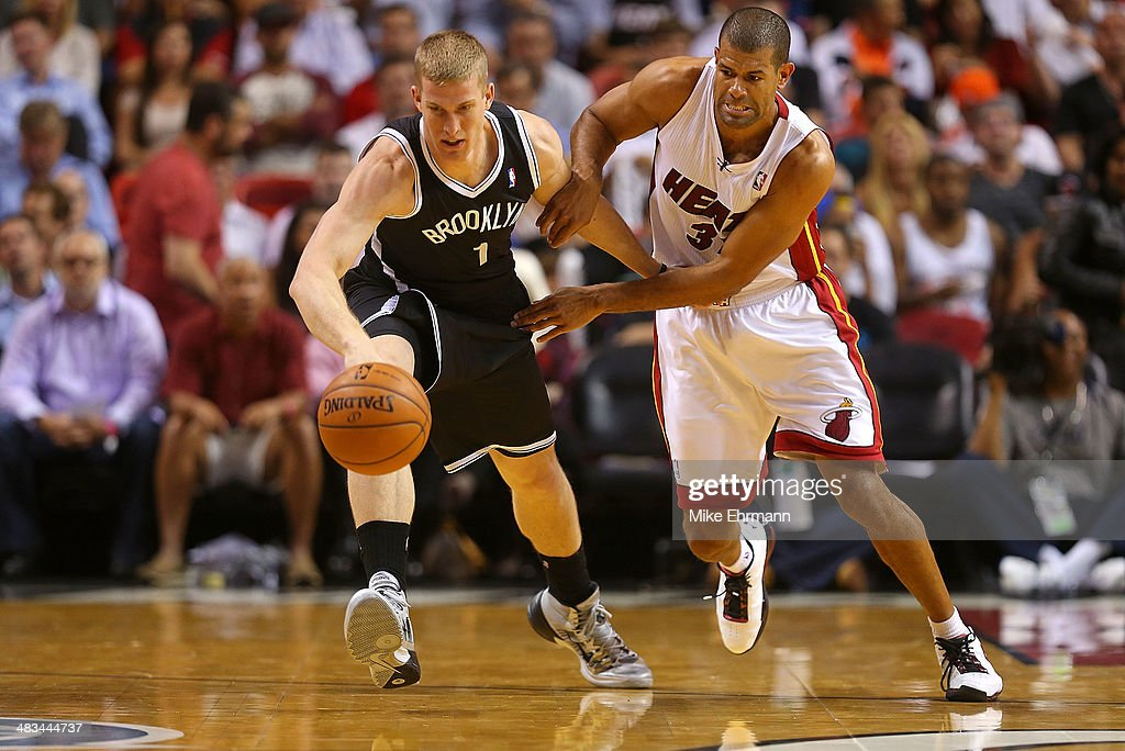 Mason Plumlee #1 of the Brooklyn Nets and Shane Battier #31 of the Miami Heat fight for a loose ball during a game at AmericanAirlines Arena on April 8, 2014 in Miami, Florida.