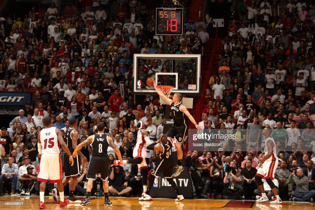 Mason Plumlee #1 of the Brooklyn Nets blocks LeBron James #6 against the Miami Heat during on April 8, 2014 at American Airlines Arena in Miami, Florida.