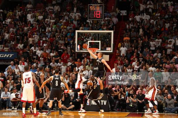 Mason Plumlee of the Brooklyn Nets blocks LeBron James against the Miami Heat during on April 8 2014 at American Airlines Arena in Miami Florida NOTE...