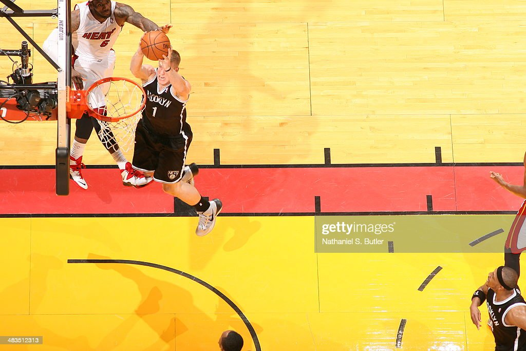 Mason Plumlee #1 of the Brooklyn Nets dunks the ball against the Miami Heat on April 8, 2014 at American Airlines Arena in Miami, Florida.