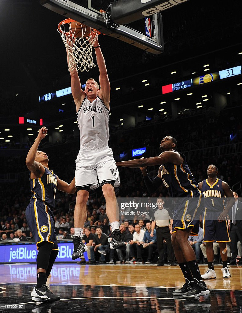 <a gi-track='captionPersonalityLinkClicked' href=/galleries/search?phrase=Mason+Plumlee&family=editorial&specificpeople=5792012 ng-click='$event.stopPropagation()'>Mason Plumlee</a> #1 of the Brooklyn Nets dunks the ball over <a gi-track='captionPersonalityLinkClicked' href=/galleries/search?phrase=Orlando+Johnson&family=editorial&specificpeople=6849358 ng-click='$event.stopPropagation()'>Orlando Johnson</a> #11 of the Indiana Pacers during the second quarter at Barclays Center on November 9, 2013 in the Brooklyn borough of New York City.