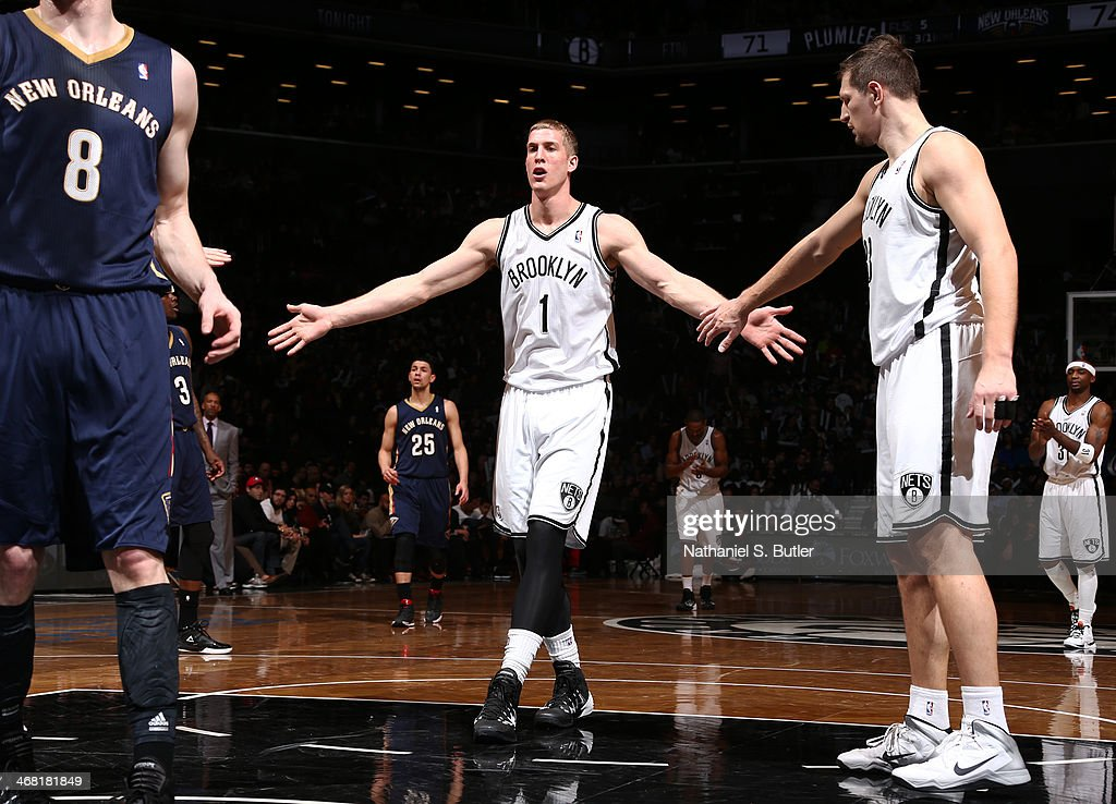 <a gi-track='captionPersonalityLinkClicked' href=/galleries/search?phrase=Mason+Plumlee&family=editorial&specificpeople=5792012 ng-click='$event.stopPropagation()'>Mason Plumlee</a> #1 of the Brooklyn Nets gets a high-five from teammate <a gi-track='captionPersonalityLinkClicked' href=/galleries/search?phrase=Mirza+Teletovic&family=editorial&specificpeople=2255667 ng-click='$event.stopPropagation()'>Mirza Teletovic</a> #33 of the Brooklyn Nets during a game against the New Orleans Pelicans at the Barclays Center on February 9, 2014 in the Brooklyn borough of New York City.