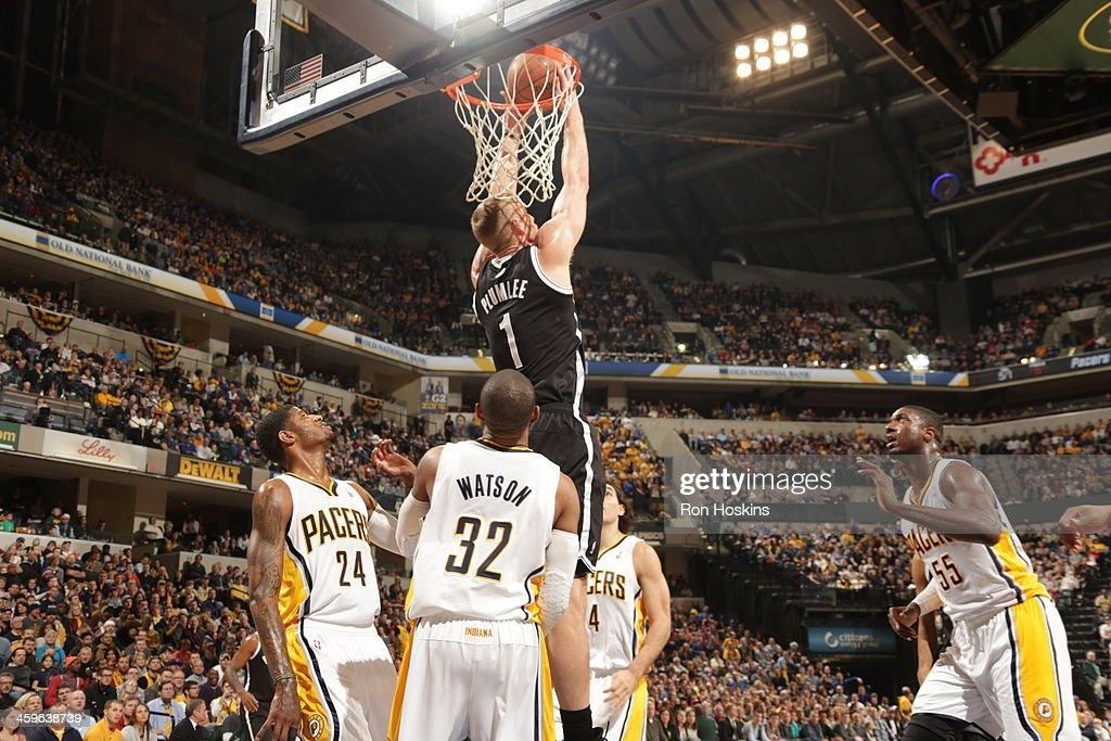 Mason Plumlee #1 of the Brooklyn Nets goes up for the reverse dunk against the Indiana Pacers at Bankers Life Fieldhouse on December 28, 2013 in Indianapolis, Indiana.